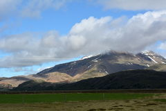 Multicolored rhyolite mountains and snow peaks in the area of the eastern fjords in Iceland Royalty Free Stock Photography