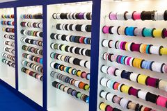 Multicolored ribbons and braid in sewing shop. Multicolored ribbons and braid in a sewing shop Stock Images