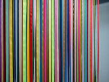 Multicolored ribbons hanging from ceiling Stock Photo