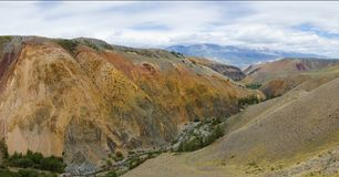 Multicolored ridges of the Kyzyl-Chin valley. Panoramic view from the mountain. royalty free stock image