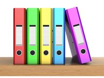 Multicolored ring binders. 3d clipart the multicolored five folders in row on the wooden shelf Stock Photos