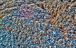 Multicolored rock Stock Photography