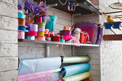 Multicolored rolls with ribbons on the shelves Stock Images