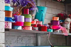 Multicolored rolls with ribbons on the shelves Stock Image