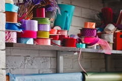 Multicolored rolls with ribbons on the shelves Royalty Free Stock Photos