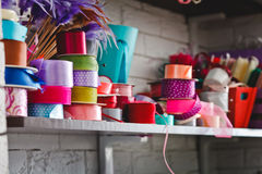 Multicolored rolls with ribbons on the shelves Stock Photo