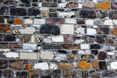 The multicolored  rough stone wall Royalty Free Stock Photos