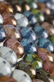 Multicolored round beads in background pattern Royalty Free Stock Photo
