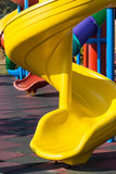 Multicolored round slides with yellow one in foreground. Multicolored round slides with yellow one in foreground in bright sunlight and soft surface stock photography