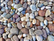 Multicolored round stones pebbles background. Multicolored round stones or pebbles background Stock Photography