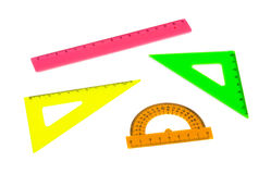 Multicolored rulers. Isolated on white background Stock Photos