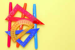 Multicolored rulers and pen Royalty Free Stock Photos