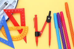 Multicolored rulers and pen Stock Image