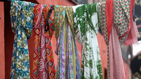 Multicolored scarfes in a row. Royalty Free Stock Photo