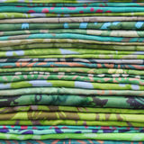 Multicolored scarfs on a shop counter, pile of colorful fabric . Shallow depth of field Royalty Free Stock Photos