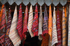Multicolored scarves on display in Moroccan market Royalty Free Stock Images