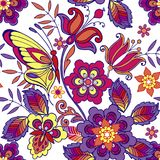 Multicolored seamless pattern with flowers and butterflies. Decorative ornament backdrop for fabric, textile, wrapping paper.  Royalty Free Stock Photo