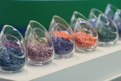 Multicolored seeds on the exhibition stand. Agriculture Royalty Free Stock Photos