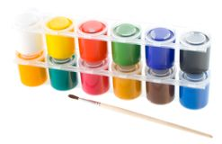 Multicolored set of gouache painting with brush Stock Photography