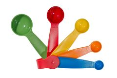Multicolored set of plastic measuring spoons royalty free stock photo