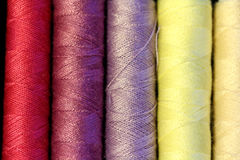 Multicolored sewing threads Stock Photos