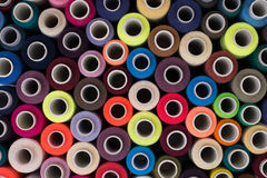 Multicolored sewing threads background Stock Photos