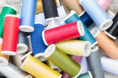 Multicolored sewing threads background Stock Photo