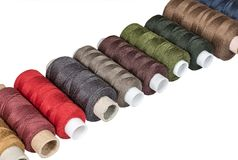 Multicolored sewing threads bobbins Royalty Free Stock Photography