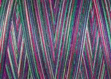 Multicolored sewing  threads in spool, surface, macro Royalty Free Stock Photos