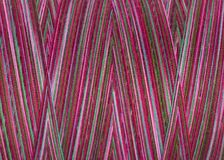 Multicolored sewing  threads in spool, surface, macro Royalty Free Stock Images