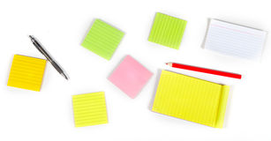Multicolored sheets of paper on the table Royalty Free Stock Photos