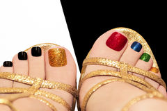 Multicolored shining pedicure. Royalty Free Stock Image
