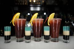 Multicolored shots and cocktails on a ba. R counter against a dark background Royalty Free Stock Images