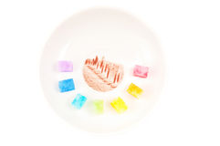 Multicolored shugar on the plate Stock Photos