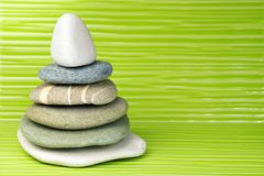 Multicolored six zen stones on a wavy surface royalty free stock photos