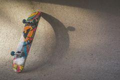 Multicolored Skateboard Leaning on Wall Stock Photography