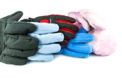 Multicolored ski gloves. Varied in size isolated on white background Stock Images