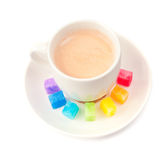 Multicolored slabs of shugar and cup of coffee Stock Photo