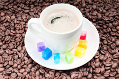 Multicolored slabs of shugar and cup of coffee Stock Image