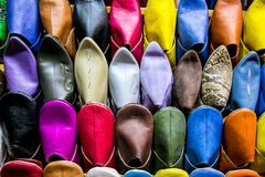 Multicolored slippers from Morocco. Babouche made in Morocco in Marrakesh; Moroccan babouches slippers for men handmade Stock Photos