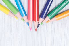 Multicolored slips of pencils, close-up, on a light background, lie on top royalty free stock photography