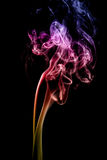 Multicolored smoke on a black background Royalty Free Stock Photos