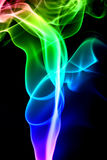 Multicolored smoke isolated on a black background Royalty Free Stock Photo