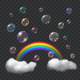 Multicolored soap bubbles, rainbow and clouds Stock Photography