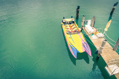 Multicolored speedboat ready to sail Royalty Free Stock Photos