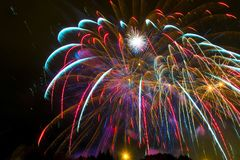Multicolored splashes of bright beautiful salute in the night bl Royalty Free Stock Photos