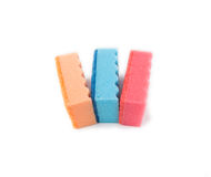 Multicolored sponges for washing dishes. On a white background stock photography