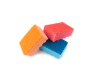 Multicolored sponges for washing dishes. On a white background stock images