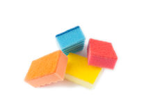 Multicolored sponges for washing dishes. On a white background Royalty Free Stock Photo