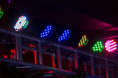 Multicolored spotlights. The disco multicolored spotlights in darkness Royalty Free Stock Images